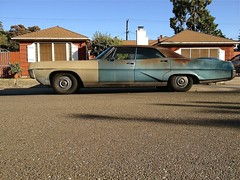 Bonne Villa (misterbigidea) Tags: street blue shadow red house classic hardtop car sedan landscape beige rust gm view muscle decay steel tan rusty neighborhood repair duplex hotwheels pontiac bonneville horsepower beater generalmotors mismatched twotone gasguzzler