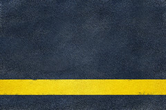 iStock_000013814358Small (TMG The Maintenance Group Ltd) Tags: road park street city urban bus texture bicycle sign yellow closeup speed warning way outdoors highway paint track day pattern traffic symbol pavement parking surface row line safety direction land backgrounds roadside straight asphalt marking reserved forward textured dividing