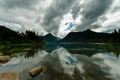 Calm lake (Usstan) Tags: sky lake mountains water norway clouds norge nikon rocks no sigma wideangle sunnmre mreogromsdal reflecions rsta 816mm d7000