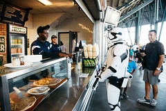 A First Order Stormtrooper orders a beer at the concession stand. (poopoorama) Tags: dannyngan dannynganphotography garrisontitan mariners nikoncorporation nikond600 safecofield seattle starwars starwarsnight starwarsweekend washington unitedstates