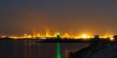 Lichtvervuiling (zsnajorrah) Tags: industrial lighthouse beacon sea water reflection pier industry steelfactory smoke chimney windturbine night longexposure 7dmarkii ef1635mmf4l netherlands ijmuiden zuidpier tatasteel