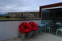 Caminha, 7 de Setembro de 2016 (*F~) Tags: caminha portugal rainyday modern ancient time emptiness empty red chairs clouds ol inside outside