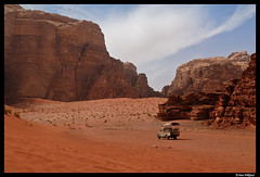 Wadi Rum desert transportation (Dan Wiklund) Tags: orange car desert jeep wadirum hill middleeast sunny hills jordan d200 2011