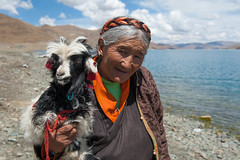 Old Woman and her Goat (vividcorvid) Tags: china old people woman lake water animal architecture kid women asia farm goat places tibet historic domesticated yamdrokyumtsolake