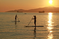 A passing glance on the water (Eyesplash - There is a change in the air.) Tags: sunset woman man reflection water vancouver board ships paddle container englishbay paddling reflexo standup relfex mfcc mountainskayak