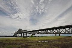 on a grey day in July (Mr. Greenjeans) Tags: bridge clouds landscape louisiana batonrouge mississippiriver 12mm canonefs1022mmf3545usm mrgreenjeans gaylon mississippiriverbridge horacewilkinsonbridge gaylonkeeling