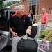 Chancellor Randy Woodson digs right in and grabs some bags during move in.Staff