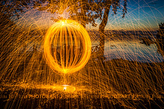 Fireball (Chrisseee) Tags: sunset orange lake black silhouette night finland dark fire dock spinning steelwool wirewool kukkia