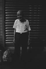Evening presence (Yubai K) Tags: old light people urban blackandwhite bw man streets film night last corner dark nikon asia mood quiet decay district 28mm taiwan silence midnight lonely taipei f3   trix400