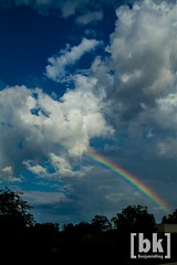 rainbow (benjaminking1) Tags: blue red sky orange white green yellow clouds rainbow violet indigo bluesky arkansas puffy roygbiv