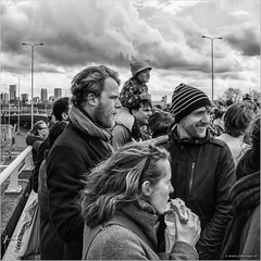 Happy faces (John Riper) Tags: park street sky people bw white black netherlands monochrome smiling festival skyline clouds canon john square photography mono kid rotterdam child zwartwit candid dramatic l carfree 6d 24105 straatfotografie kleinpolderplein autoloos riper johnriper