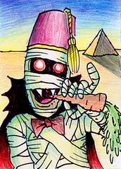 Mummula (Tom Bagley) Tags: canada calgary atc desert pyramid cartoon fez alberta carrot sharpie colouredpencils tombagley mummula