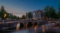 Amsterdam Movement : Keizersgracht Long Exposure (l3v1k) Tags: ifttt 500px city sunset water travel light outside tourism architecture lights bridge building boats town long exposure canal outdoors dusk trails street nobody night shot canals built structure connection exterior starburst grachtengordel europe amsterdam north holland netherlands keizersgracht benelux western keisergracht nikkor 20mm afd nikkor20mmafd lighttrails longexposure nightshot