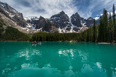 Canoeists on Moraine Lake (NettyA) Tags: 2014 alberta banff banffnationalpark canada canadianrockies northamerica sonynex6 mountains travel canoeing canoe clouds morainelake aqua colour reflection