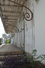 White rustic city building porch in Marigot Collectivit de Saint-Martin France French side of the island of Saint Martin FWI French West Indies (RYANISLAND) Tags: france french saintmartin stmartin saint st collectivity martin collectivityofsaintmartin collectivit collectivitdesaintmartin marigot frenchcaribbean frenchwestindies thecaribbean caribbean caribbeanisland caribbeanislands island islands leewardislands leewardisland westindies indies lesserantilles antilles caribbees