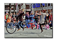 Up in the Air (The Bop) Tags: buskers crowd kids adults dancing unicycle hoops street outdoor frame