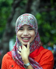 IMG_8130fr (Mangiwau) Tags: girl smiling scarf indonesia asian tanya veil braces teeth hijab gigi sulawesi islamic headdress minta mete kebun kacang dentures jilbab berani aswin cewek kendari gigit sultra behel laode