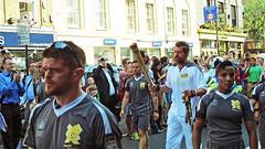 Torch Relay, Upper Street (Herschell Hershey) Tags: street stella inspiration london phil crowd security flame trust british olympics islington mccartney tracksuit packer london2012 davidwalliams olympictorchrelay