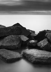 looking east (StephenCairns) Tags: morning blackandwhite bw canada burlington canon rocks lakeshoredrive lakeontario beforesunrise spencerpark stephencairns 50mmcanonf14 canon5dmarkii unfilteredle