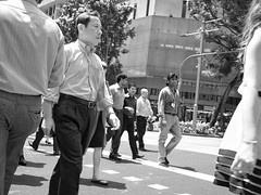 IMG_0485 (rannasoriano) Tags: road street plaza city portrait people urban bw white black fashion businessman portraits walking asian four singapore asia candid id formal streetphotography orchard busy micro 20mm sg thirds orchardroad lanyard mirrorless microfourthirds