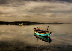 in the clouds (Nejdet Duzen) Tags: trip travel sea cloud reflection turkey boat trkiye deniz sandal izmir bulut yansma turkei seyahat buoyant mygearandme yeniakran