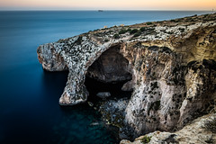 Blue Grotto - Malta - Seascape photography (Giuseppe Milo (www.pixael.com)) Tags: longexposure travel blue light sunset sea sky orange cliff sun seascape motion yellow clouds landscape geotagged photography photo rocks europe fuji mt malta grotto fujifilm cave onsale ultrawide fujix xe2 fuji14 ilqrendi fuji14mm fujixe2