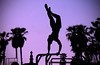 the muscle man (jolanta mazur) Tags: silhouette venicebeach musclebeach upsidedown acrobat acrobatics sunset california handstand gymnast gymnastics backlight