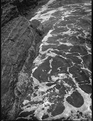 rocks, surf, foam, Pemaquid Point, Maine, Mamiya 645 Pro, Ilford HP4+, R5 Monobath Developer, 8.24.16 (steve aimone) Tags: rocks surf foam patterns ocean atlanticocean pemaquidpoint pemaquid maine midcoast mamiya645pro ilfordfp4 r5monobathdeveloper mediumformat 120 film landscape
