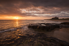 Bamburgh Gold (Tracey Whitefoot) Tags: tracey whitefoot 2016 summer northumberland north east coast coastal bamburgh castle sunrise dawn beach gold golden rocks sky