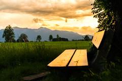 Bavaria (--Conrad-N--) Tags: bavaria field sunset seat bayern mountains benediktbeuern reflection