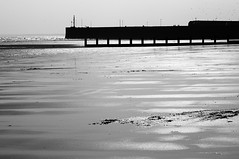 Spring sun at low tide (Richie Rue) Tags: nikond300 outdoors spring sun tide beach sand sea coast coastal silhouette seashore shore reflection reflected harbour shimmer shine landscape mono monochrome blackandwhite