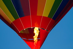 We have liftoff (Mukumbura) Tags: hotairballoon liftoff takeoff flight flying flame fire heat rainbow colours red orange yellow green blue indigo purple sky