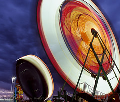 Flying Saucers (MattyD90) Tags: california county longexposure carnival summer sky motion color mamiya film rain clouds fun lights amusement fairgrounds movement sanjose slide august diving fair spotlight santaclara rides bluehour rb67 flyingsaucers