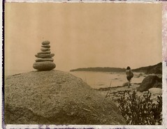 balancing act (snacky.) Tags: ocean summer film beach water stone polaroid rocks land instant modified balance marthasvineyard expired 450 choco 2012 mv cedartreeneck 127mm roidweek
