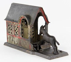 2001. Cast Iron Mechanical Bank Mule Entering Barn
