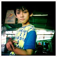 Phnom Penh, Cambodia (gardnergp) Tags: travel boy look shop photo asia cambodia postcard wash moto curious phnom penh