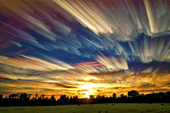 Smeared Sky Sunset (Matt Molloy) Tags: trees sunset sky test motion field lines clouds fun photography timelapse crazy movement experiment madness neat colourful trippy streaks success smeared haybails photostack mattmolloy probablyboth onsomething ontosomething