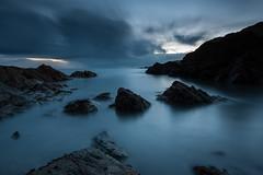Rising Tide (Rob Ferrol) Tags: light sea cloud seascape motion rock sunrise photography rising dawn coast spring rocks solitude harbour tide calm rob tides daybreak ilfracombe ferrol
