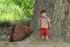 Am i cute ? (Iqbal.Khatri) Tags: life pakistan boy baby cute colors childhood self children closed happiness hopes hunza gilgit opendoor colorsoflife iqbal taught baltistan khatri northpakistan lifehood