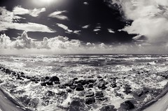 Galveston Surf (Tom Haymes) Tags: blackandwhite galveston gulfofmexico clouds rocks surf waves texas seawall fisheye galvestontexas texasgulfcoast