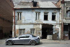 Decay & a Tuned Car in Tbilisi, Georgia (Simon Christiaanse) Tags: street old city car shop contrast georgia decay capital streetphotography 32 tbilisi sakartvelo   flickraward5 simonchristiaanse