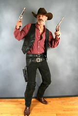 Cowboy Up (Cowboy Tommy) Tags: portrait hairy black hot sexy leather cowboy boots handsome moustache jeans western guns vest stache mustache tight plaid levis cowboyhat holster bulge lanky capguns