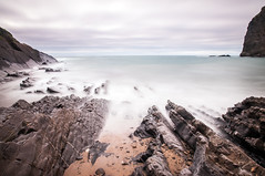 Ebbing Closer (Graham00McFarlane) Tags: longexposure sea sand rocks cornwall tide pebbles quartz crackingtonhaven