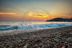 beach in Himara, Ionian sea, Albania (azem) Tags: sunset summer vacation sky beach water canon relax eos evening sand rocks crystal dusk horizon dramatic wave clear 5d balkans relaxation albania idyllic 2012 markii himara