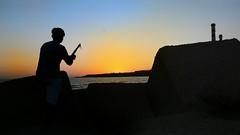 Pesco il tramonto (vitoegiusy) Tags: mare portoempedocle pesca tramonto sicilia sicily italy italia nuvole cielo scoglio canna spiaggia azzurro nero bella belle beach water sole roccia cannelle