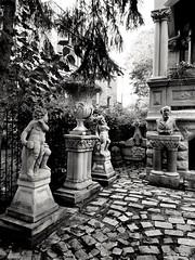 (williamw60640) Tags: statue bust romanesquearchitecture yard cobblestone columns stone statuary cherub fence ram urn vase chicago trees famousfigure