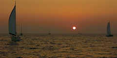 Stunning sunset on the Aegean Sea (somabiswas) Tags: santorini boats sailboats sunset aegean sea greece sailing seascapes