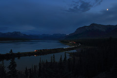 Nightfall at Swan Landing (Moffat Road) Tags: canadiannational cn night nightfall twilight nighttime waxingmoon moon bluehour swanlanding brule alberta freighttrain robertsonscurve cnedsonsubdivision azure train railroad locomotive curve lake brulelake mountains canada ab