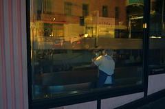 Closing Time (MPnormaleye) Tags: worker shop store sunset sundown dusk window reflection machinery urban city neighborhood utata 24mm