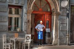 waiting 2 (stevefge) Tags: krakow poland oldtown reflectyourworld people candid street men waiting bar stone summer zomer restaurant